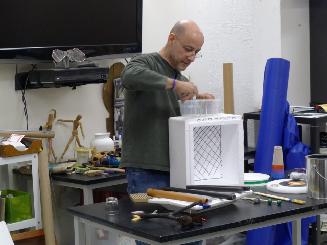 Louie Miranda making an instrument